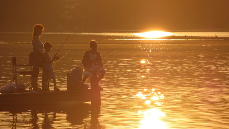 Mom and boys fishing - sunset